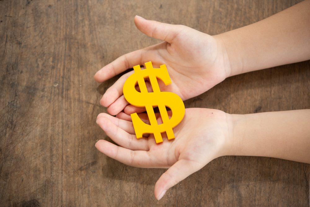 CDI, Mão com símbolo de Cifrão representando o dinheiro