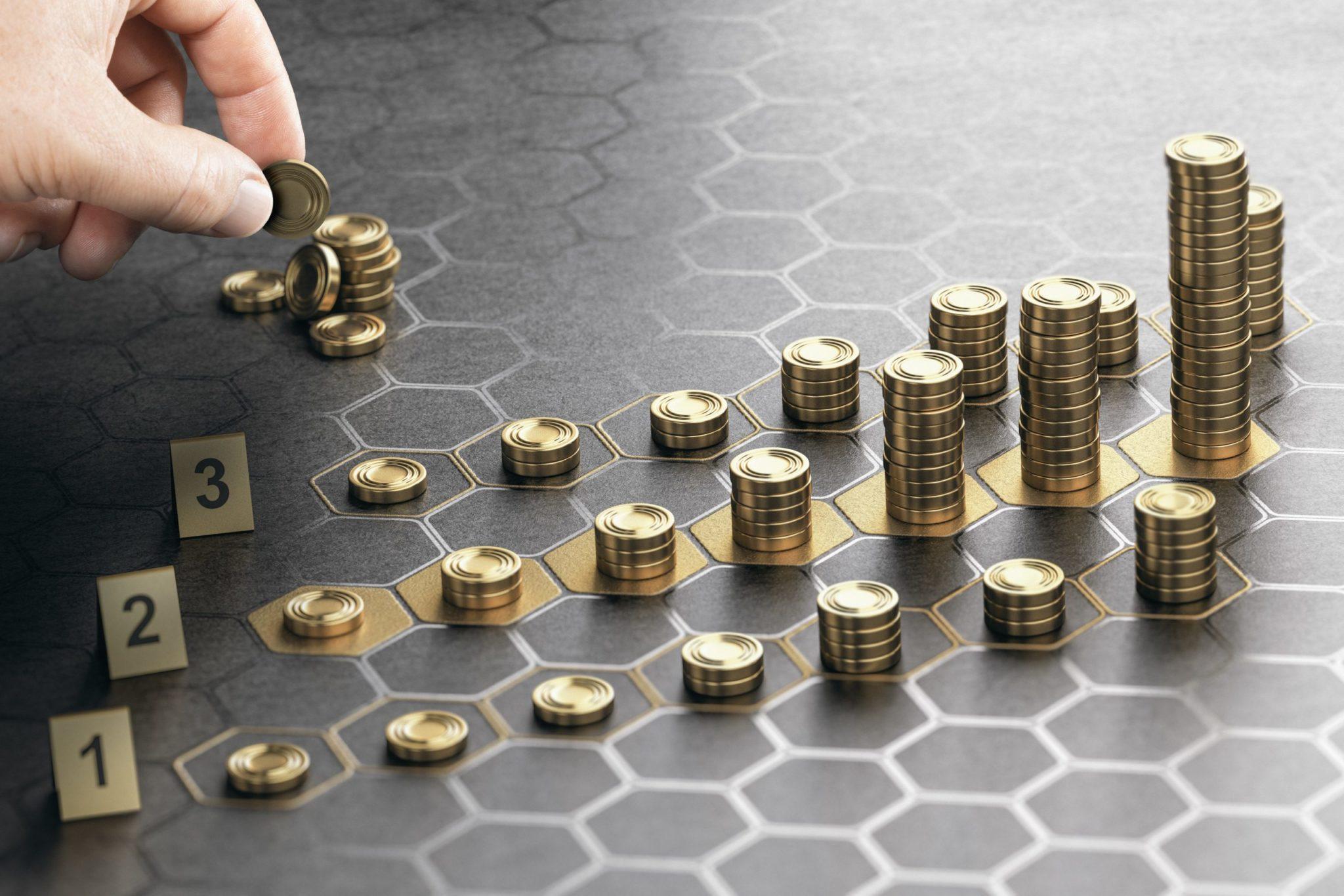 Pilhas de moeda representando a rentabilidade