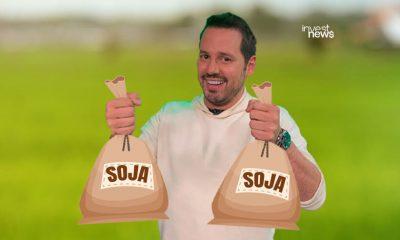 dony de nuccio segurando dois sacos de soja