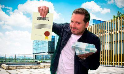dony de nuccio com um contrato e dinheiro nas mãos