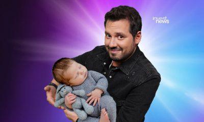 Dony De Nuccio com um bebê no colo
