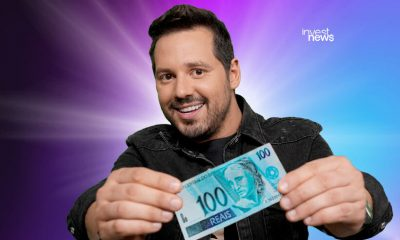 Dony De Nuccio com nota de cem reais na mão